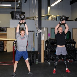 Luke and Dan enjoy starting their day with heavy kettlebells.