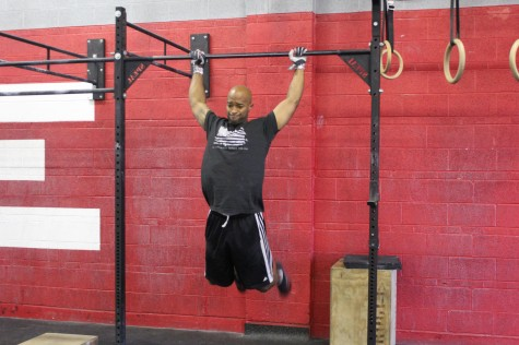 Jay, gearing up for a bar muscle-up.