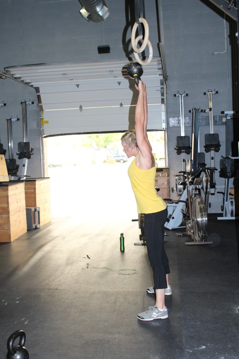 Erin definitely making sure that kettle bell is locked out overhead.