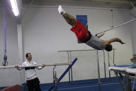 Jim using his fitness for some gymnastics!  What is he flying into and why is that guy smiling??