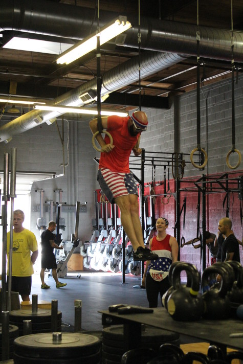If this doesn't scream America, then nothing does.  James taking care of business during the July 4th partner WOD.