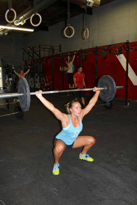 Meghan strong in her overhead squat.