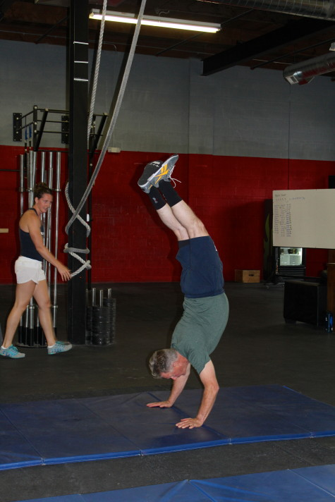 Howard showing age is just a number and practicing HS in Zink's gymnastics skills sessions.