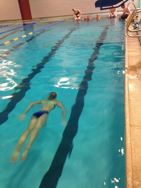 Lillie going the distance. . . the whole length of the pool underwater. Fun times  had at swim WODs.