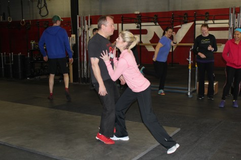 Kent taking a beating while Laura puts into practice some of her new basic self defense moves.