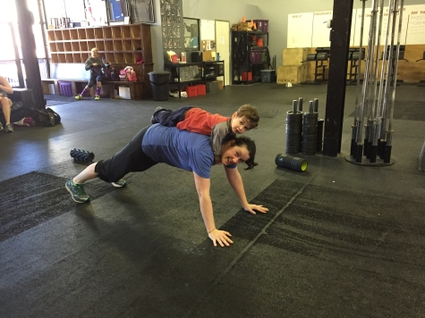 Sara and Harrison showing us how to properly do a weighted plank hold.