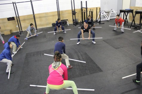 Coach Robyn teaching a group of 5th graders from Maxwell Elementary School , the sumo deadlift high pull. Starting 'em young with CrossFit.
