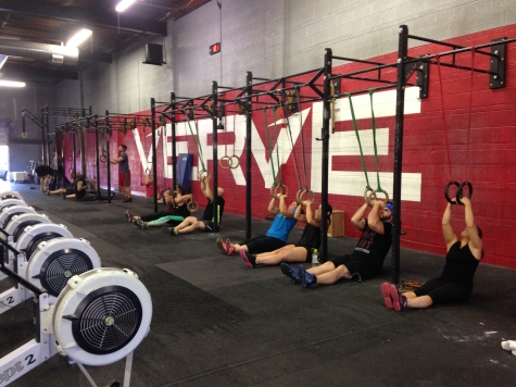 Verve's fitness minions praying to the muscle-up gods. . . or doing a modification mid WOD to improve their muscle-ups.