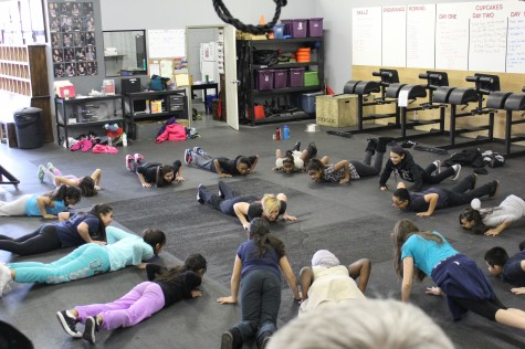 Anna teaching 5th graders appreciation for the burpee early in their fitness journeys.