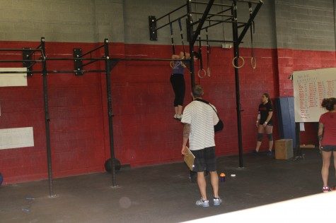 Maddie working through muscle ups during 15.3.