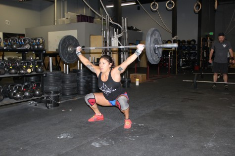 Mia fighting to maintain good position during a high volume of light weight overhead squats.