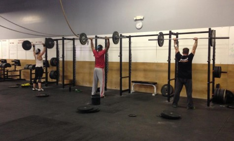 Trainer power hour. Maddie, Jay, and Eric getting some heavy shoulder presses in.