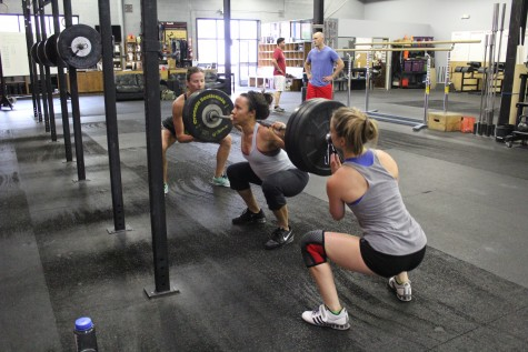 Shelle working on her 3RM back squat with Meghan and Stephanie spotting her. Team work makes the dream work.