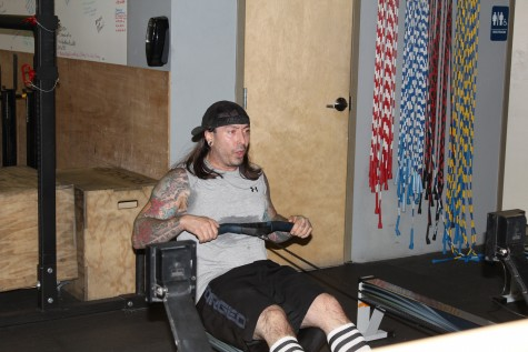 Patrick looking focused during a rowing workout.