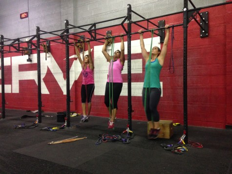 Bridget, Anahita, and Erin building their pulling power with strict pull-ups.