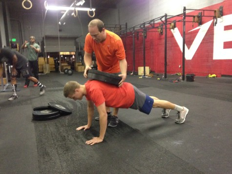 David helping Jordan through some weighted push-ups.