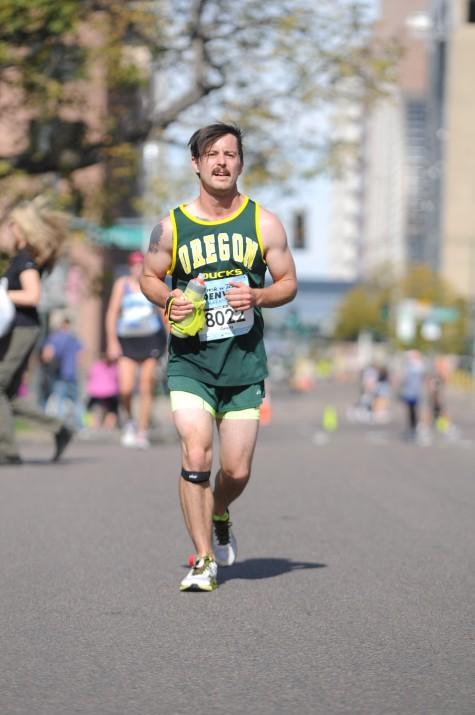 Greg finishing up his first marathon.