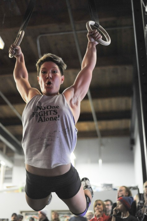 Emily taking care of muscle ups and always ready for a photo!