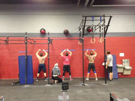 Nate, Clancy, and Zink working through 16.4 under the watchful eyes of their judges.