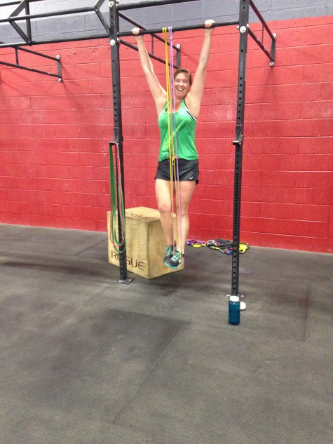 Annie is so happy to be working on strict pull-ups. . . or she's happy that it's the weekend!