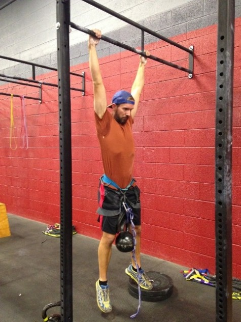 Andrew doing some weighted pull ups, with his custom built weight supporting apparatus.