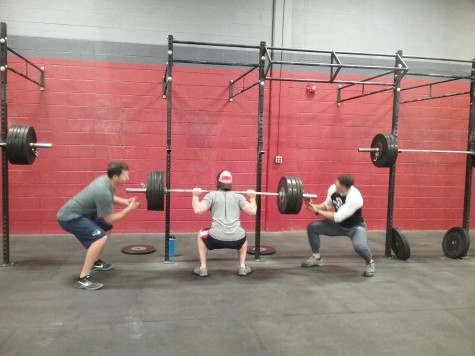 Greg with a solid back squat PR under the watching eyes of Stan and Jeremy.