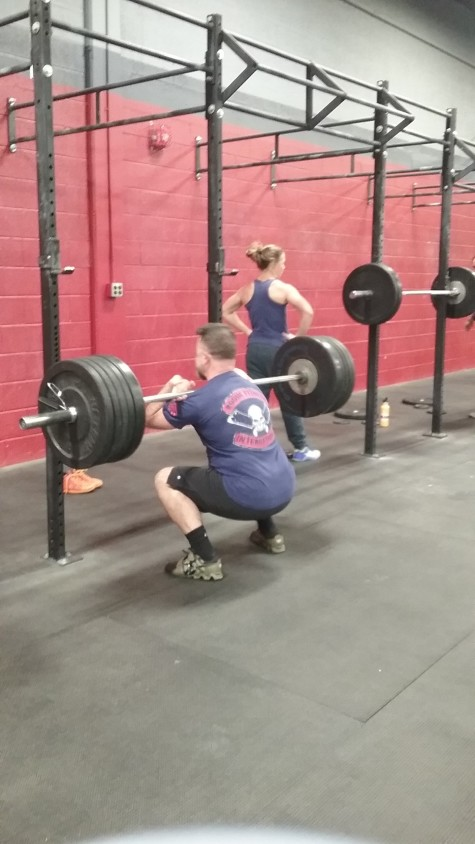 Brendan showing some solid front squat form while Bailey does the hardest part.... Adding up those weights!