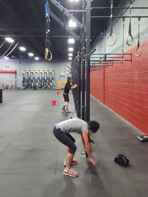 Joannie moving so fast she's blurry and Greg keeping pace during yesterdays' burpees