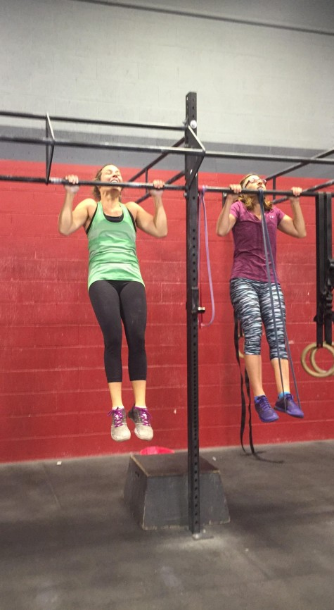 Katie and Christine working through some pull ups, smiles and all ;)