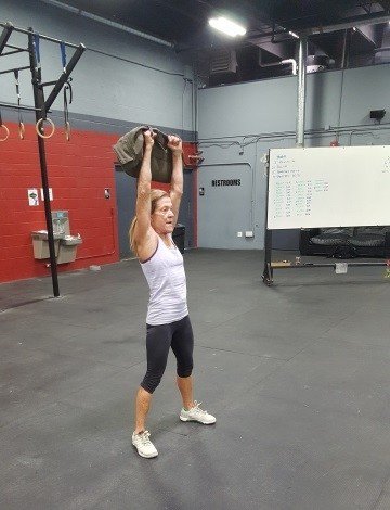 Joannie using a sandbag for thrusters during last weeks workout.