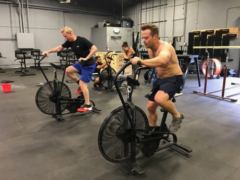Dueling Adams on the assault bikes.