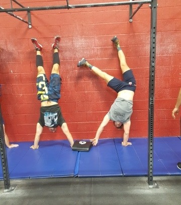 Nate and Mick playing pass the ab mat while inverted. Try it! It's not easy