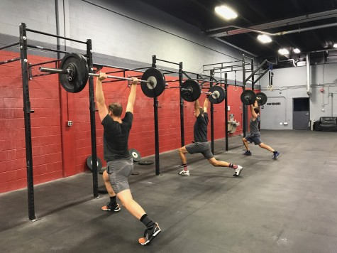 The guys in grey (Eric, Alex, and, Andrew) working on their split jerk. . . and outfit coordinating.