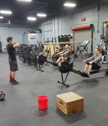 Kaplan, Folse, and Julie getting warmed up for Front Squats